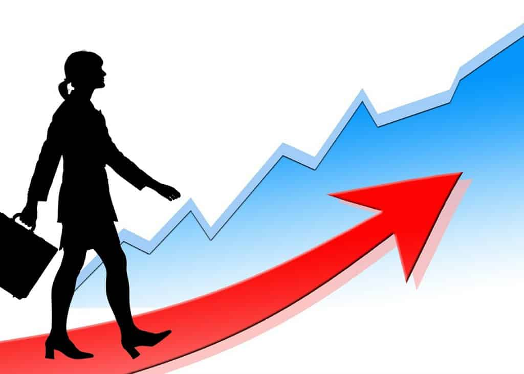 illustratiom of a women walking on a red arrow that arcs up and set in front of line chart that is also going up